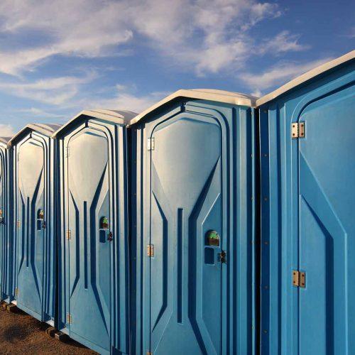 Row of portable toilets outside